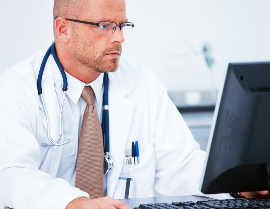 Medical - Handsome doctor using computer